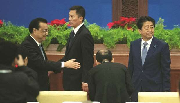 安倍晋三首相と中国の李柯強