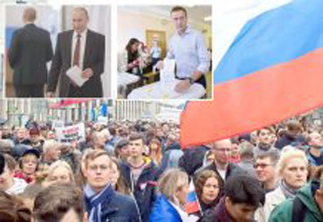 選挙日の野党支持者の抗議:ウラジミールプーチン大統領と野党党首のアレクセイナバルニーが投票